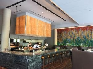 The presentation kitchen at Stephan Pyles' stunning new Flora Street Cafe.